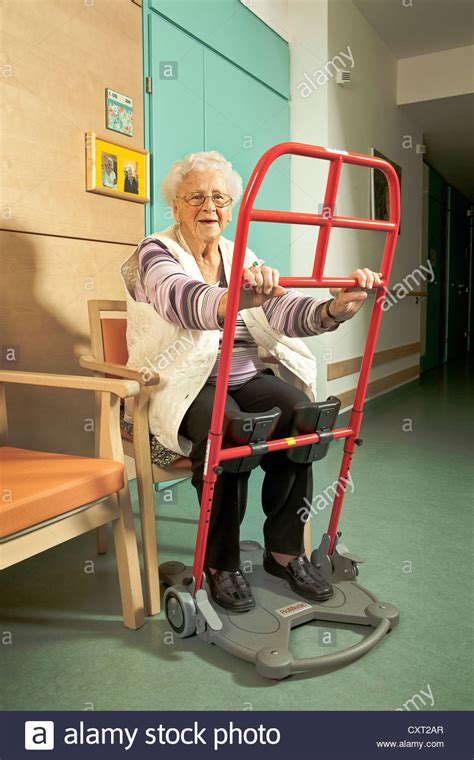 Elderly woman with an aid for standing up, nursing home